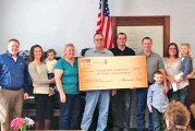 Farmer gives donation to St. Joseph-Salem Heritage Society