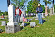 Volunteers search cemetery for veterans' grave stones