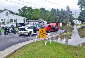 Floodwaters claim three vehicles in city of Upper