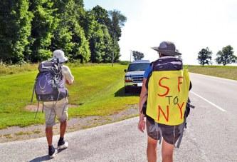 Couple walking across United States
