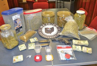 Search warrant yields gun, drugs