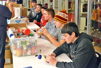 Athletes 'team up' to bring holiday cheer to less fortunate in community