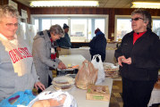 Refugee crisis hits close to home for local priest, volunteer bakery