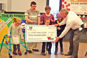 Vaughn Industries donates big check to Miracle Field project
