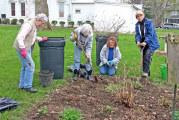 Village gardeners work in museum garden