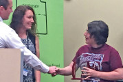Staff member recognized for community service in mental health