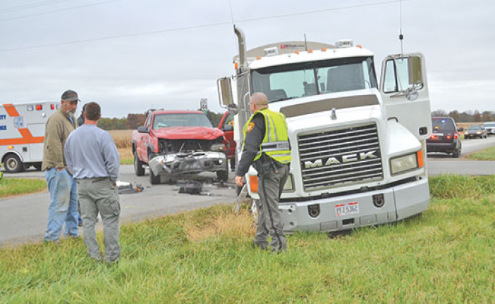 1 injured when semi, pickup collide