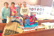 Local hands come together to send quilts to those in need across world