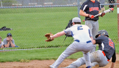 Daily Chief-Union/Avery T. Jennings Good slide Cadin Emshoff (back) slides into home plate ahead of a tag by Wyatt Smith in the fourth inning of Mohawk's 2-0 win over Wynford. The Warriors extended their win streak to 11 with the rain-shortened victory.