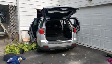 SUV hits house