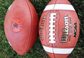 Monogramed signed footballs